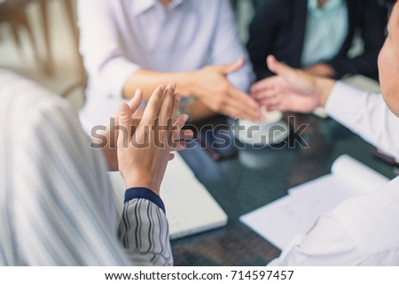 The business team is shaking hands with congratulations on the trade agreement or marketing plan. #714597457