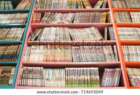 Comic books in bookshelf for background