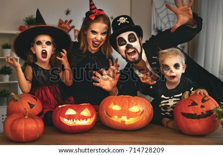 happy family mother father and children in costumes and makeup on a celebration of Halloween Royalty-Free Stock Photo #714728209