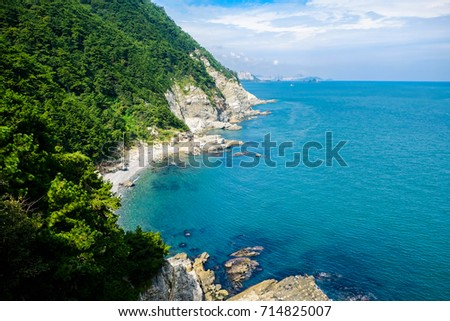 Scenery of bay consist of blue ocean, rock, mount and blue sky  with cloud #714825007