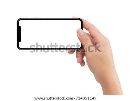 Isolated Isolated human right hand holding black horizontal smartphone phone on white background #714851149