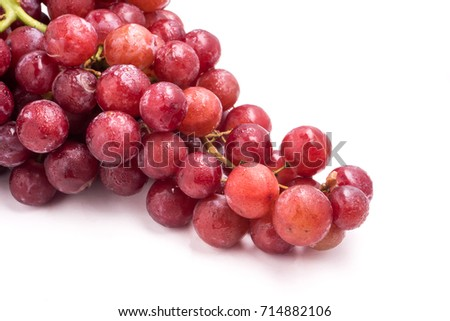 Red grapes on a white background. #714882106