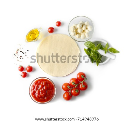 Composition with green fresh organic basil and ingredients for pizza isolated on white Royalty-Free Stock Photo #714948976