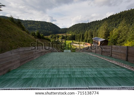 Top view of Ski jumping slope and tracks on summer #715138774