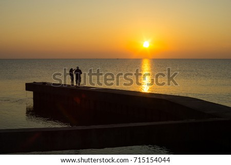 Couple in beautiful morning at the sea. #715154044