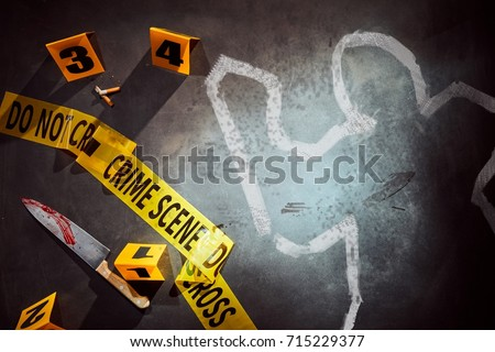 White outline of victim and bloody knife marked with number evidence markers at crime scene #715229377