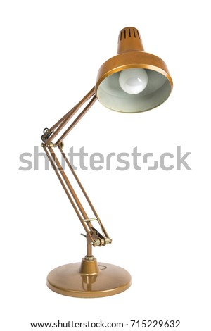 old copper colored table lamp on white background / isolated portrait of a vintage table lamp #715229632