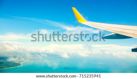 Vintage color tone of Wing of an airplane flying above the ocean. Photo applied to tourism operators. picture for add text message or frame website. Traveling concept