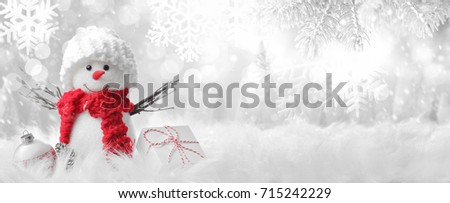 Snowman in winter setting,Christmas background. Royalty-Free Stock Photo #715242229