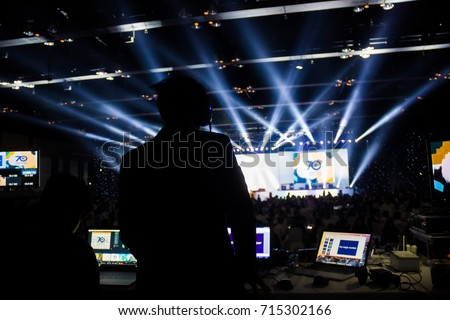 Silhouette of worker control, sound system and lighting in concert. #715302166