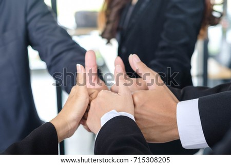 Asian business people joining hands with colleagues together at meeting time for develop job to success, business colleagues teamwork concept #715308205