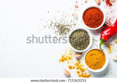 Various spices in a bowls on white background. Top view. #715363255