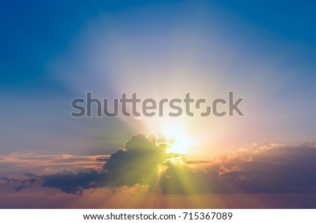 The sun's rays are visible from the clouds at dawn. Natural sunset composition #715367089