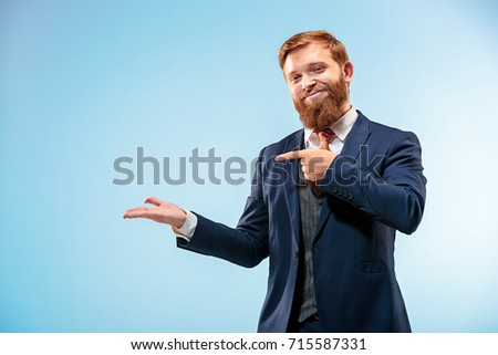 Portrait of a business man isolated on blue background. #715587331