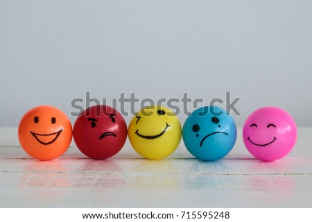 Emotions balls background, Happy Smiley faces ball in yellow , orange and pink. Sadness ball in blue and madness ball in red. Self made hand draw balls. #715595248