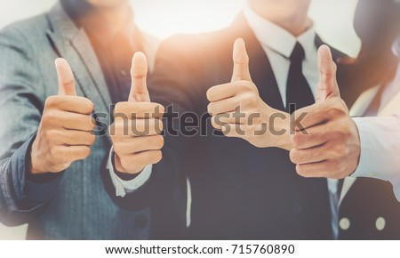 closeup portrait Businessman team showing many thumbs up expressing positivity Concept Successful teamwork and cooperation Purposiveness Same intention Organization #715760890