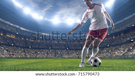 Soccer player kicks the ball on the soccer stadium. He wear unbranded sports clothes. Stadium and crowd made in 3D. #715790473