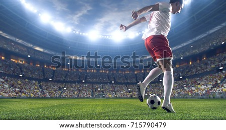 Soccer player kicks the ball on the soccer stadium. He wear unbranded sports clothes. Stadium and crowd made in 3D. #715790479