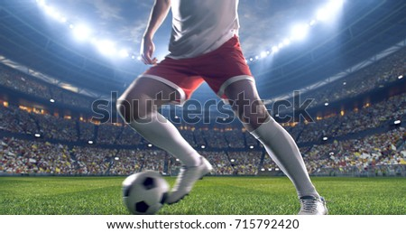 Soccer player kicks the ball on the soccer stadium. He wear unbranded sports clothes. Stadium and crowd made in 3D. #715792420