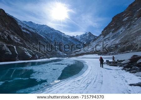 Chadar trek (The frozen Zanskar river trekking) during winter in Leh,Ladakh,Kashmir,India. Royalty-Free Stock Photo #715794370