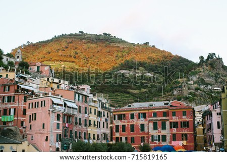 CINQUE TERRE, ITALY - CIRCA JULY 2017: Colorful houses around the harbour of Vernazza, one of the five villages of the famous Cinque Terre, northern Italy. #715819165