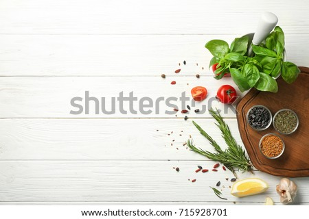 Composition with wooden board and ingredients for cooking on table Royalty-Free Stock Photo #715928701