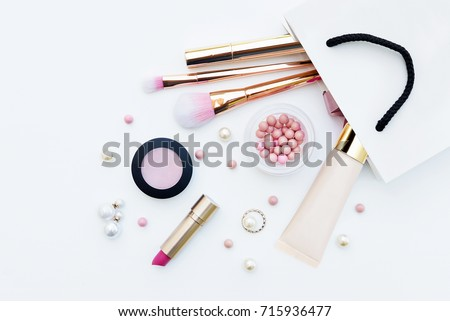 Different makeup beauty cosmetic in gift package on white background #715936477