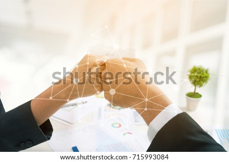 Double Exposure Business People Partners Make Fist Bump with Digital layer Business Strategy and SOCIA Media Diagram.   Business Collaboration and Partners and Supporters Together is Part of Success. Royalty-Free Stock Photo #715993084