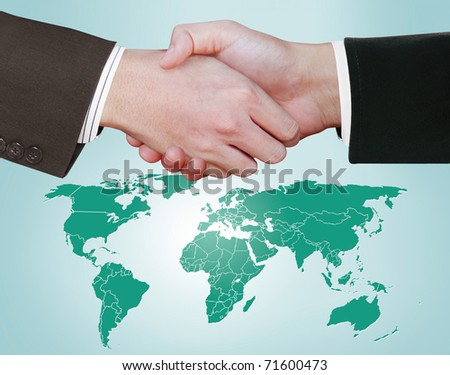 Hand shake between a businessman and a businesswoman #71600473