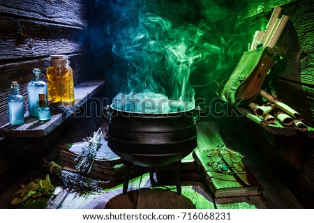 Witcher cauldron with color smoke for Halloween Royalty-Free Stock Photo #716068231