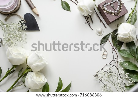 Creative mockup of accessories and flowers on a white background. A gentle and romantic concept. View from above. #716086306