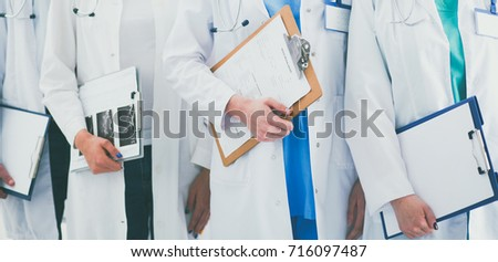 Portrait of group of smiling hospital colleagues standing together #716097487