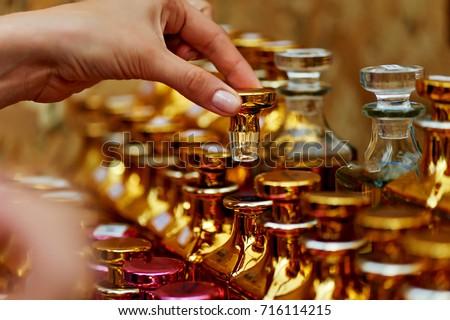 Glass perfume bottles based oils. A Bazaar, market. Macro. Gold and pink gamma #716114215