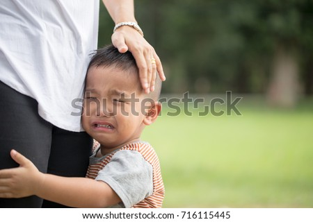 Little boy crying with his mother #716115445
