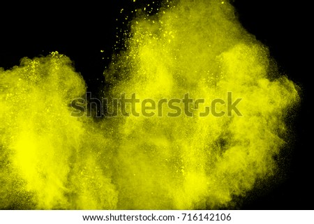 Launched colorful powder on black background #716142106