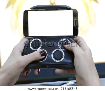 Two hands holding a smartphone with the game #716165545