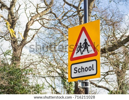 A yellow school road sign, UK.