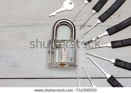 several lockpicking to open a lock on a door #716300050