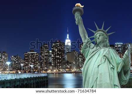 Manhattan Skyline and The Statue of Liberty at Night Lights, New York City #71634784