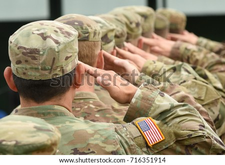 US soldiers giving salute  Royalty-Free Stock Photo #716351914