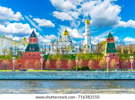 Moscow Kremlin. Towers of the Moscow Kremlin. The bell tower of Ivan the Great and the Annunciation Cathedral in the Moscow Kremlin. Moscow Kremlin against the background of a cloudy sky #716382550