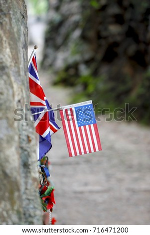 Peoples laid United States flag, bead necklace and the boomerang to commemorate POWs at Hellfire Pass of Death Railway, Kanchanaburi, Thailand #716471200
