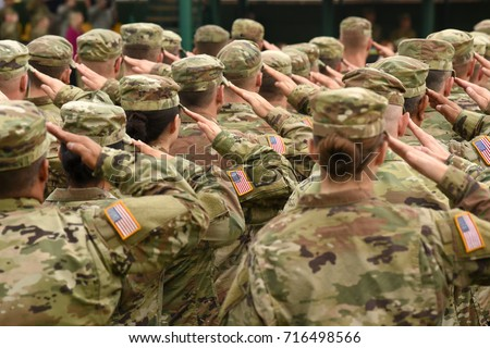US soldiers giving salute Royalty-Free Stock Photo #716498566