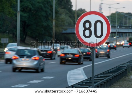 Speed limit sign with a traffic in the background #716607445