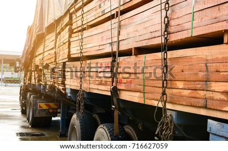 Timber transport truck Park waiting for inspection with lumber for construction.selective focus #716627059