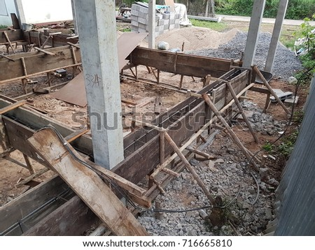 Wooden Steel deformed bars and the structure of cast concrete beams on the construction area. #716665810