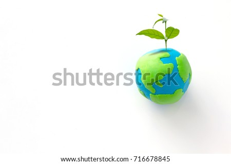 Planting tree in green globe , Environment conservation ,CSR Abbreviation or Corporate Social Responsibility #716678845