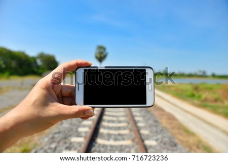 taking photo of railway track on smart phone