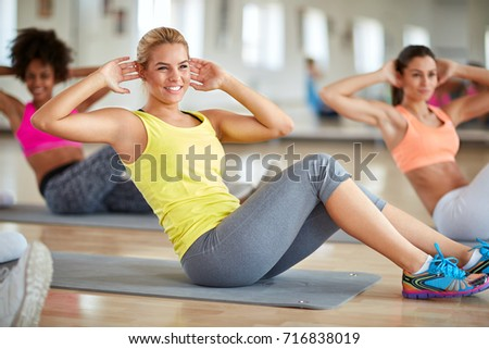 Blond female in fitness group on training in fitness class #716838019