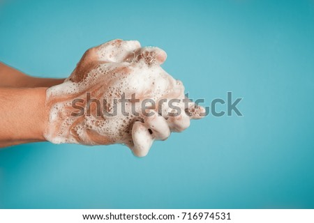 Closeup of person washing hands isolated. Cleanliness and body care concept.   Royalty-Free Stock Photo #716974531